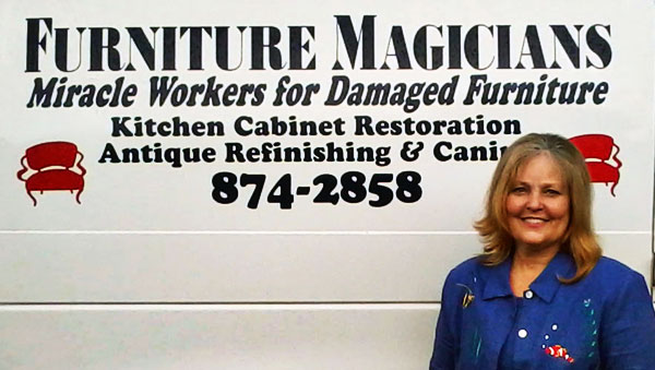 Susan Price, the owner of Furniture Magicians standing in front of our work van